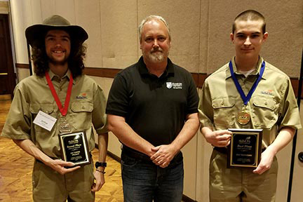 From left to right, Joshua Murphy of Smithfield; Dwight Barnes, instructor; and Matthew Carmody of Selma, first place CNC technician.