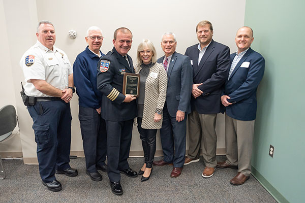 Johnston County Emergency Medical Services receiving the Industry Partner of the Year award. Members of the JCEMS are standing with Dr. David Johnson, President of Johnston CC, and Lyn Austin, Chair, Board of Directors at Johnston Community College.