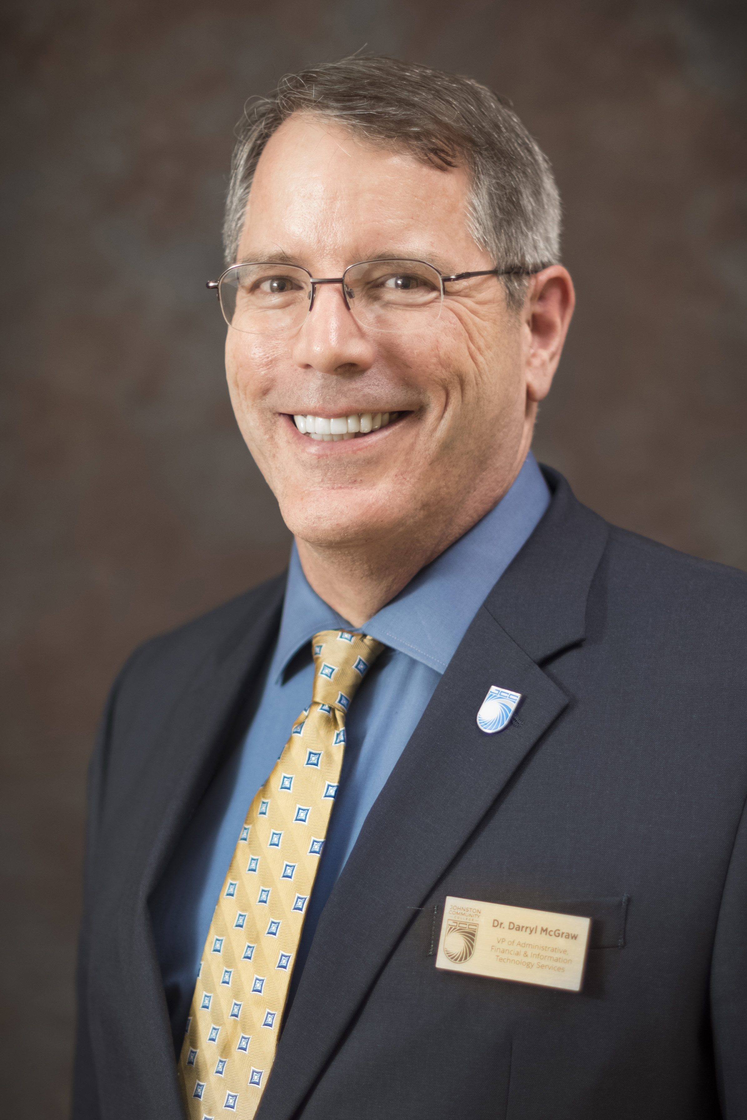 McGraw served as the college's chief financial officer.