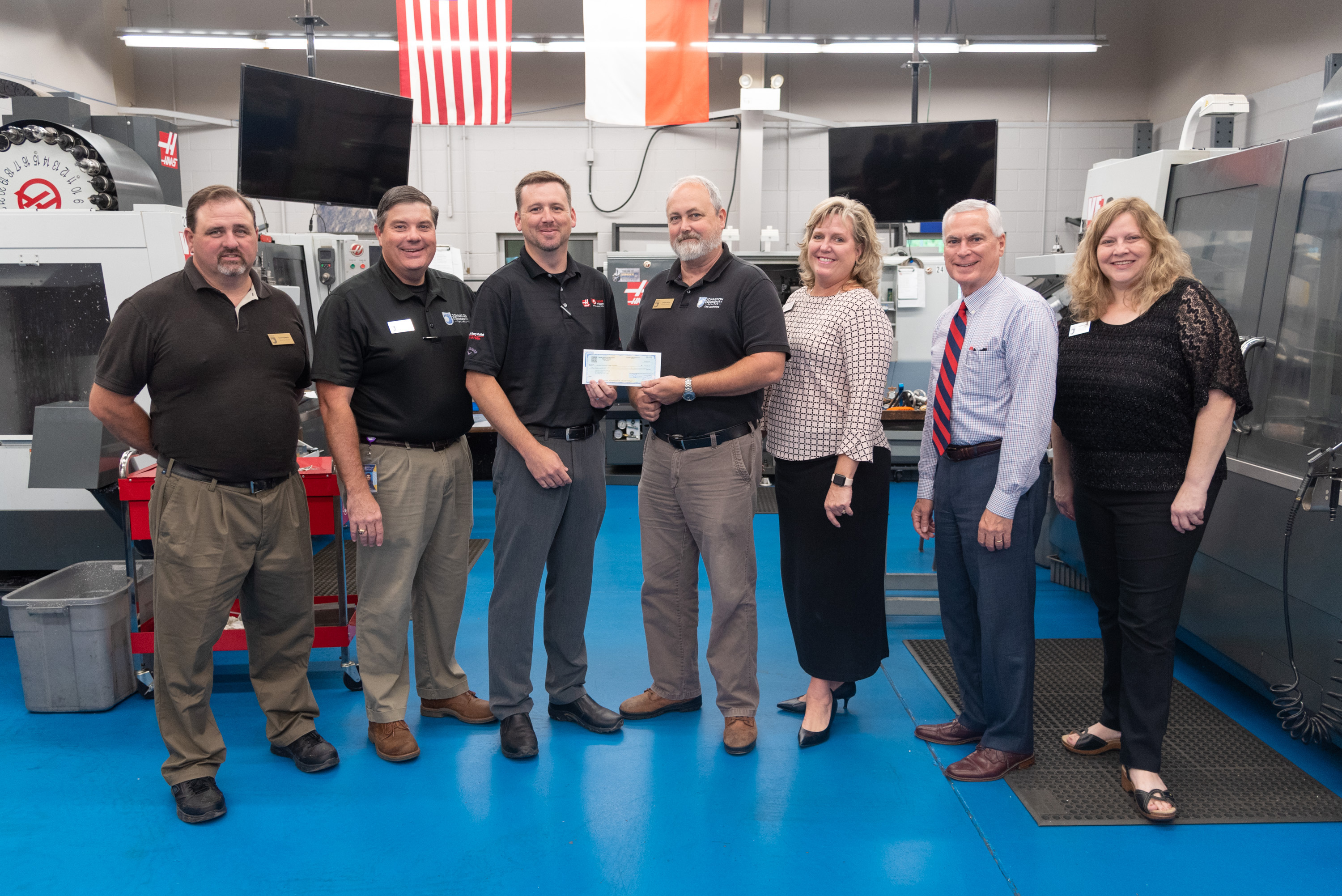 Bill Cranford of Phillips Corporation representing the Gene Haas Foundation presents a check for $15,000 to JCC officials. The funds will support scholarships for machining students at the college.