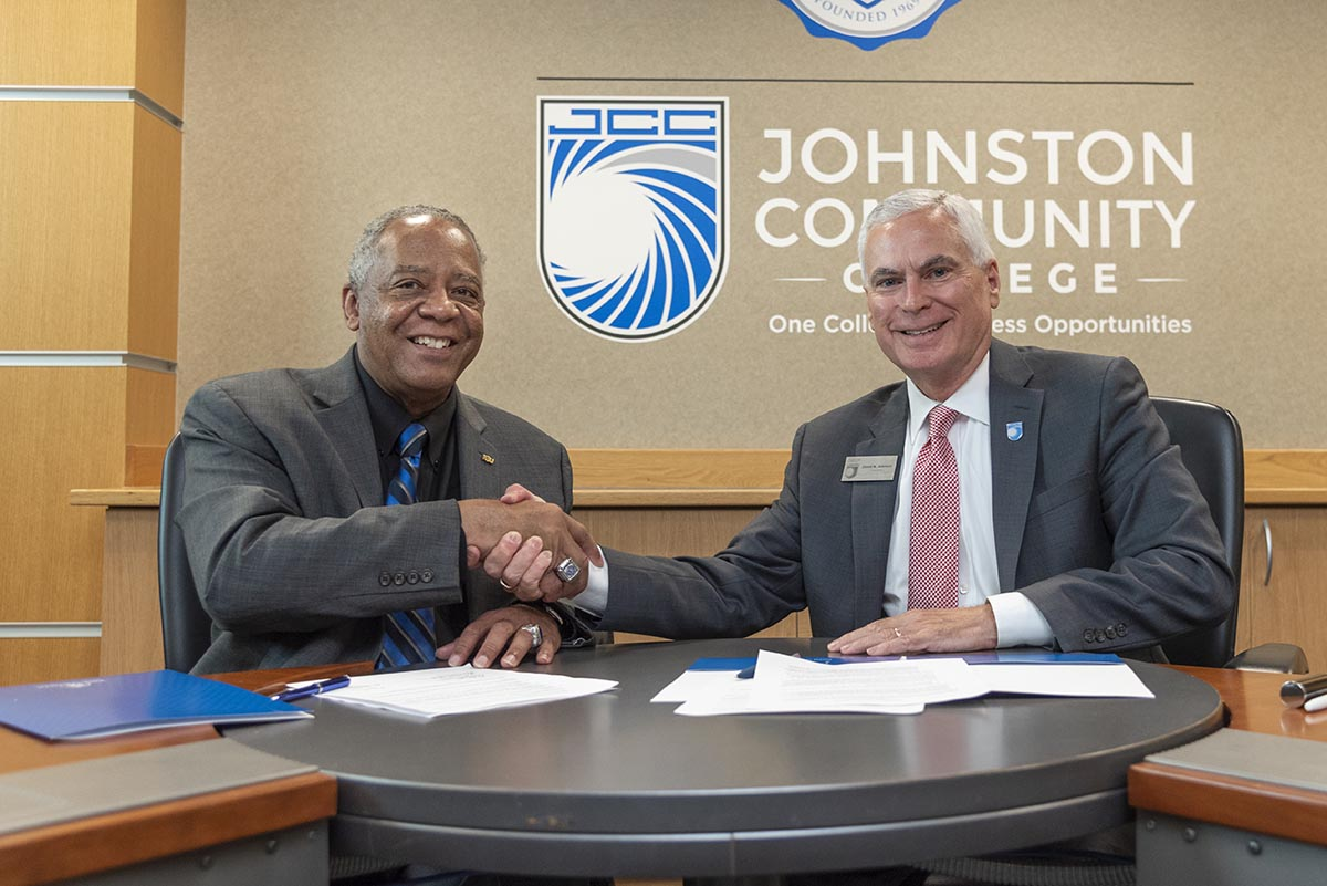 Dr. James A. Anderson, chancellor of Fayetteville State University, and Dr. David N. Johnson, president of Johnston Community College, sign their $10K Degree Pathway Partnership.