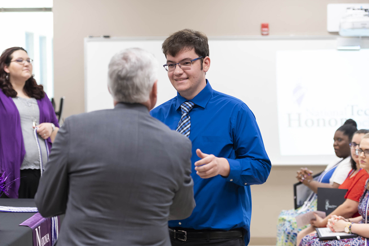 Dr. David Johnson, JCC president, congratulates Luke Thompson on his induction into the National Technical Honor Society.