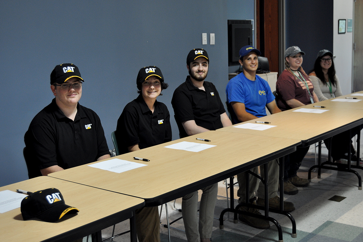 Pictured from left are Caterpillar apprentices David Linder, Kendra Ebach, and Mikhael Breault; CMC Electric apprentice Craig Ransom, and Novo Nordisk apprentices Olivia Moore and Rachel Atwell.