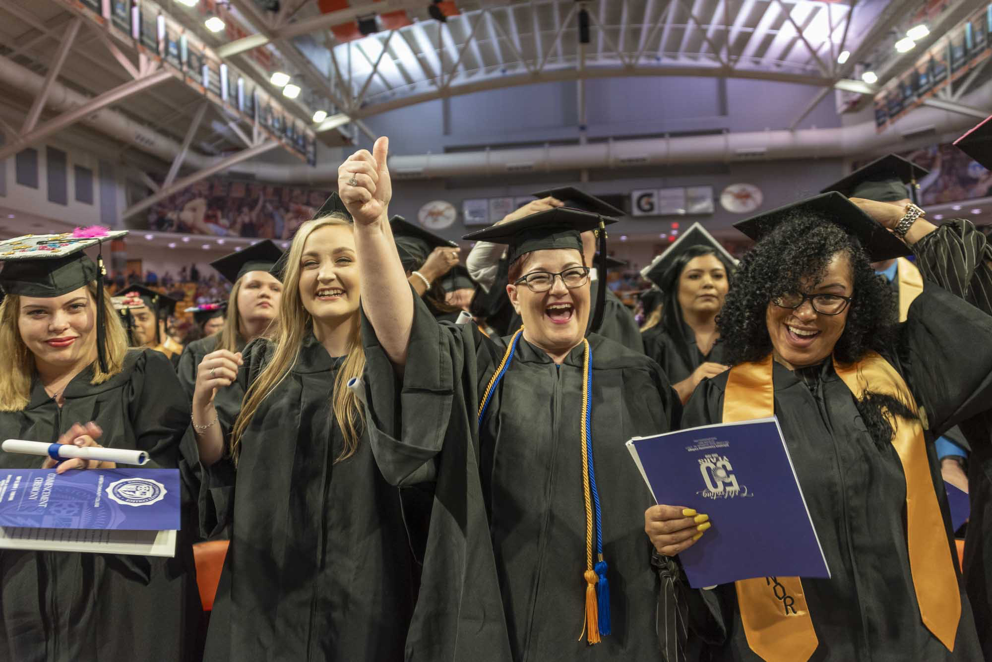 Four JCC graduates are all smiles at graduation May 13 at Campbell University.