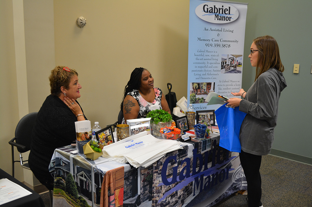 Caeley Mathews talks to Gabriel Manor staff about CNA jobs at the Clayton assisted living center.