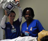 Students learning to use x ray equipment