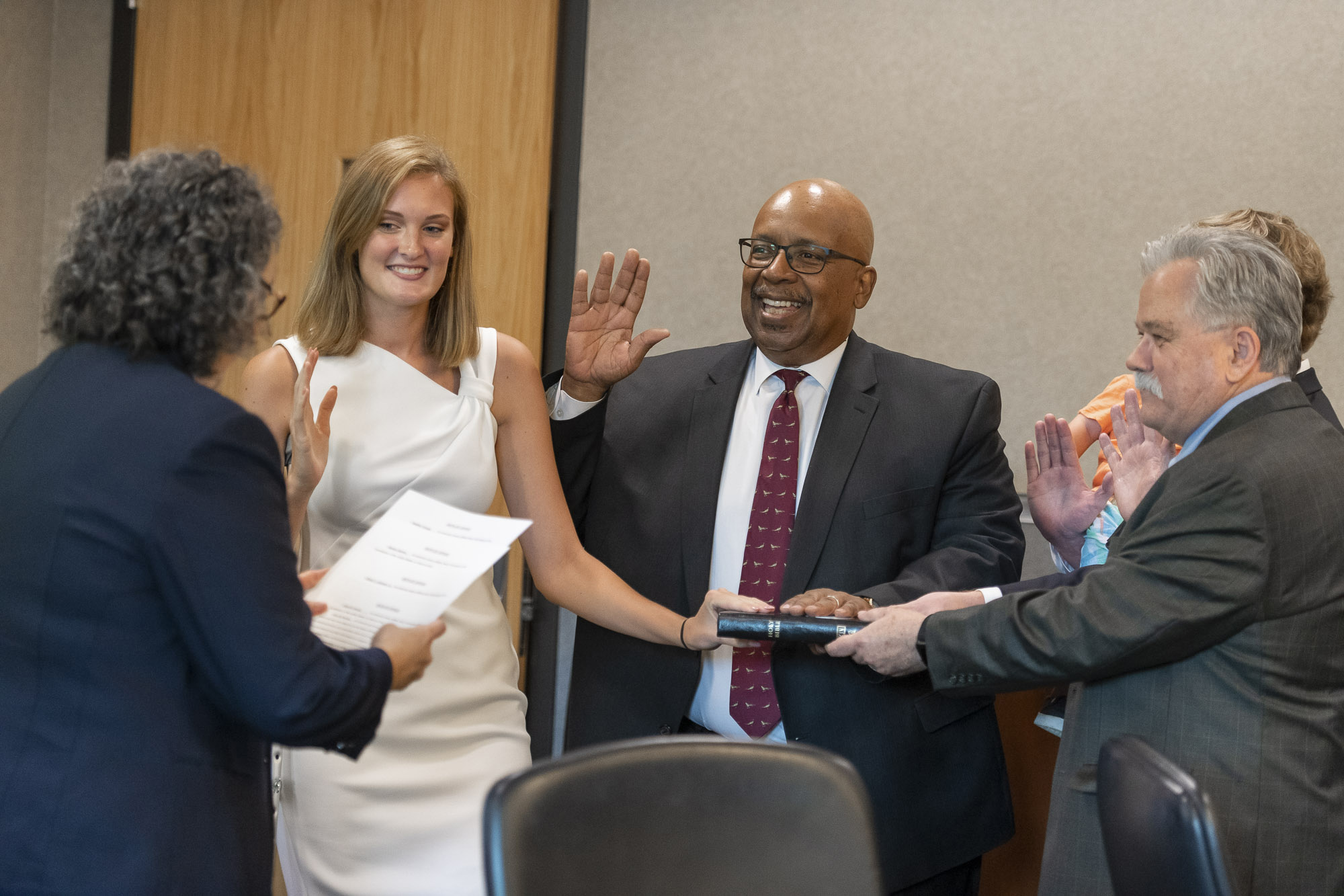 From left JCC student trustee Heather Choate; Dr. Oliver Johnson; and Hank Daniels take their oaths of office.