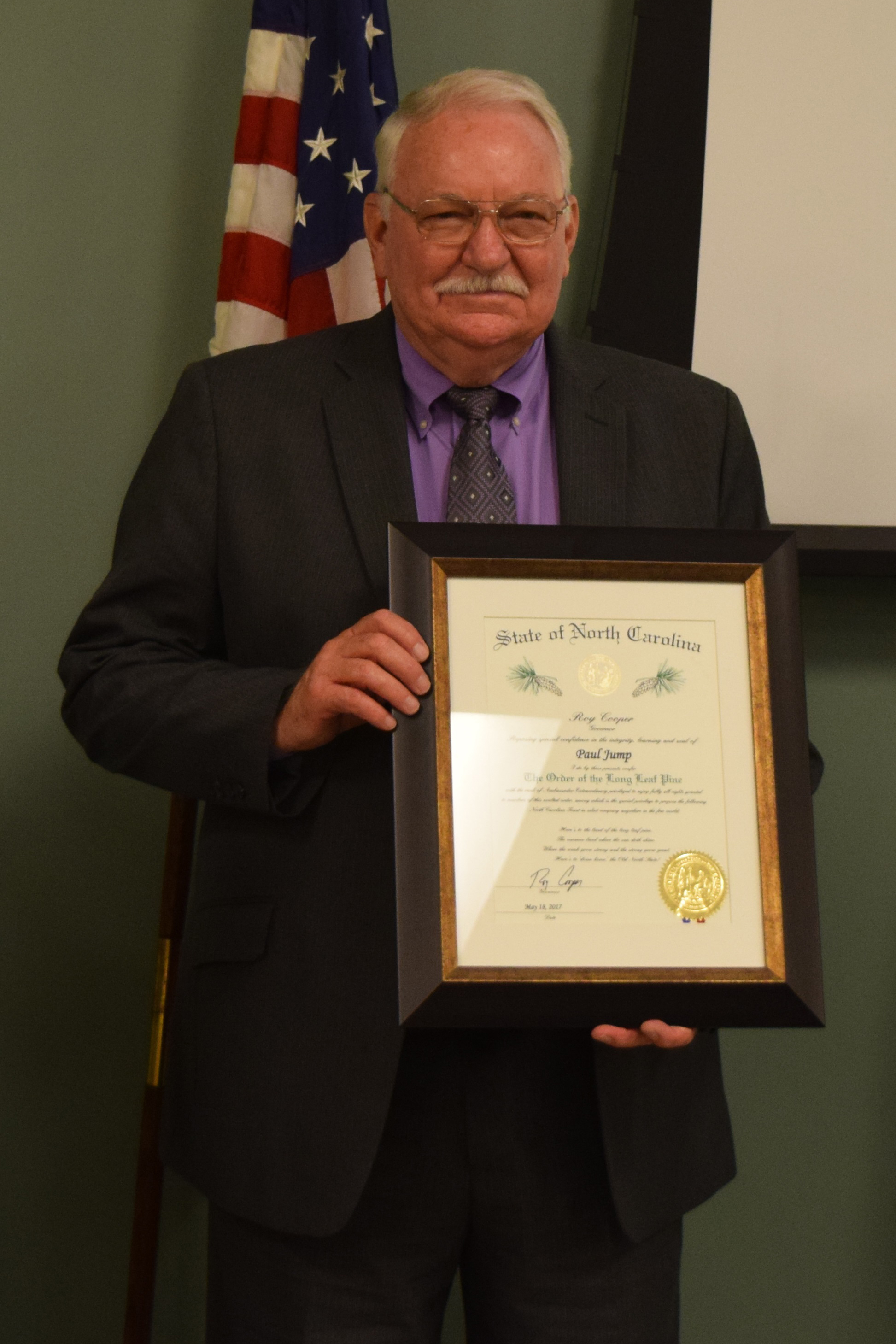 Truck driver training director Paul Jump was presented The Order of the Long Leaf Pine.