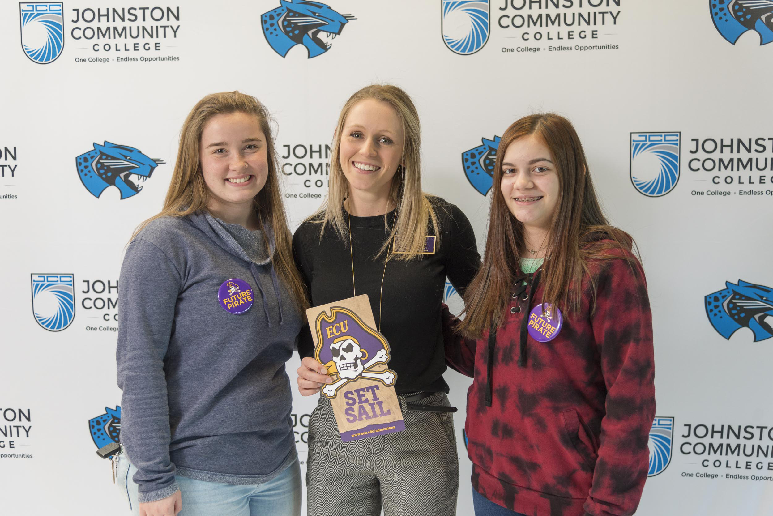 Leeann Simons of Middlesex, left, and April Wagner of Clayton are two of the 28 future Pirates in the new dual admissions programs with JCC and ECU. They are pictured with Sydney Luyster, an ECU admissions counselor.