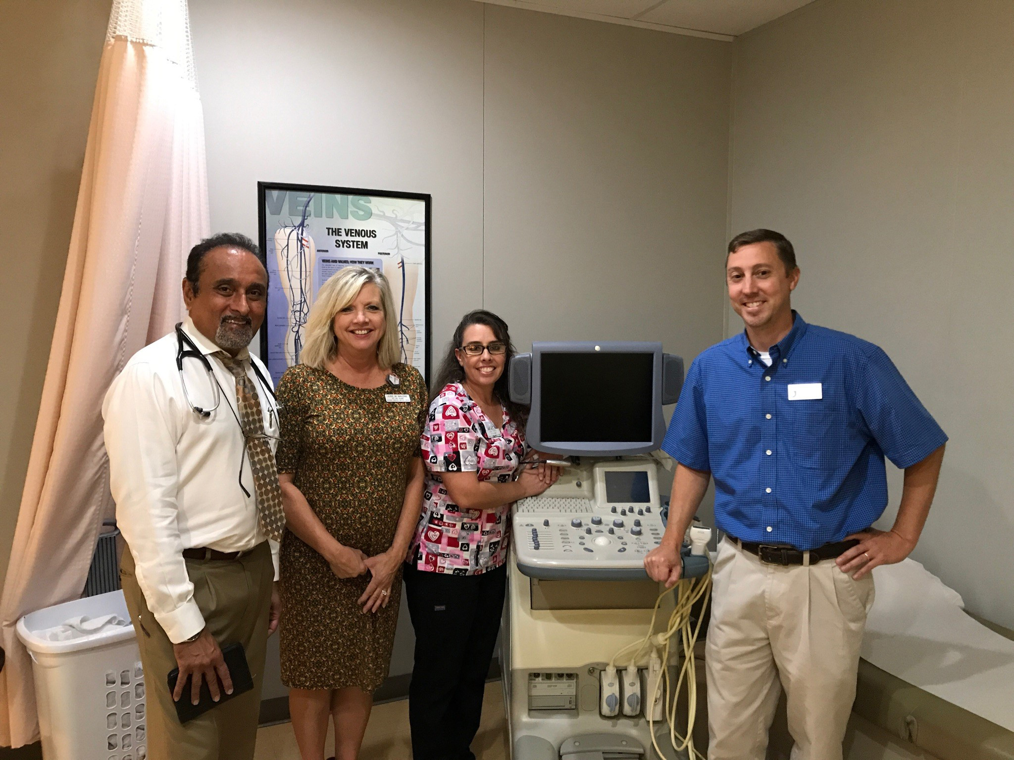 Dr. P.K. Vyas, June Malone, and Lisa Penny, of Eastern Carolina Medical Center; and Steven Penny, JCC sonography instructor, are pictured with the donated ultrasound machine.